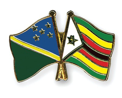 Crossed Flag Pins Solomon-Islands-Zimbabwe