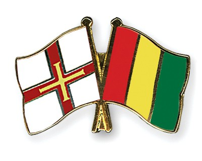 Crossed Flag Pins Guernsey-Guinea